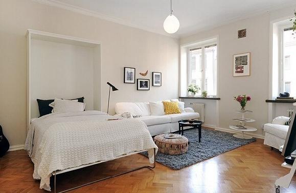 Разделение спальни на зоны диван и кровать