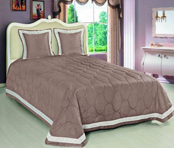 Стеганное покрывало на кровать