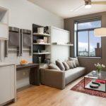 Двуспальная кровать-диван-шкаф в светлом серо-бежевом интерьере