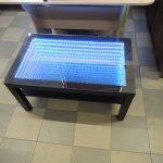 стол с эффектом бесконечности фото