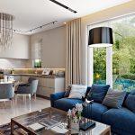 В гостиной синий диван с подушками