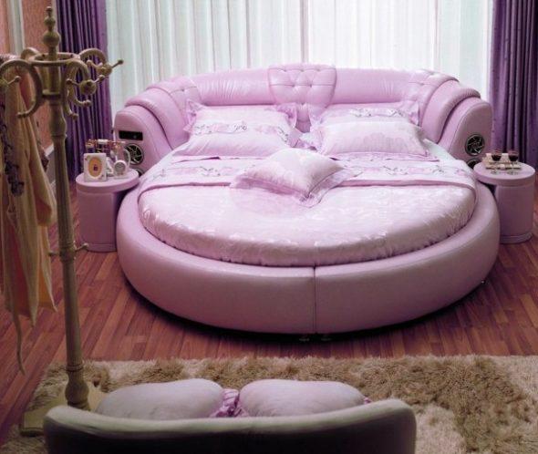 Дизайн очень нежной спальни с необычной кроватью круглой формы