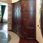 Стильный угловой шкаф для оригинальной стенки