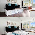 Кровать-подиум с диваном в центре комнаты