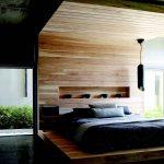 Стильное оформление спальни с кроватью-подиум