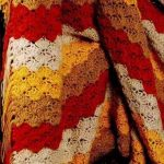 Яркое сочетание полос четырех цветов для уютного пледа