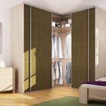 Угловой шкаф для спальни с ротанговыми вставками