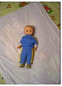 Расстилаем одеяло на угол(