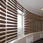 Декорирование больших окон рулонными шторами