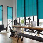 Голубые роликовые шторы для высоких окон в кабинете