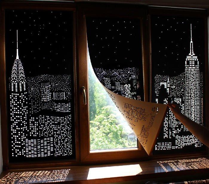 Приоткрытая штора с перфорацией ночного города