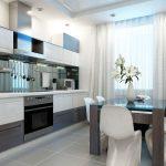 Светлые гардины дополняют интерьер кухни в светло-коричневых тонах