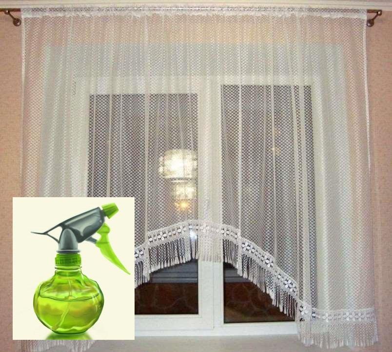 Капроновая тюль с бахромой на окне кухни