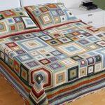 Шикарный плед спицами из квадратов в комплекте с подушками