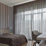 Интерьер спальни в оттенках серого цвета