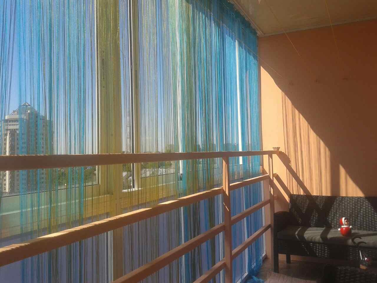 шторы на балконе кисея
