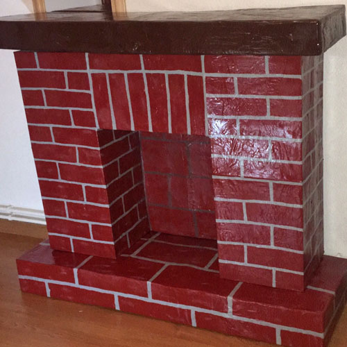 Покраска фальш-камина из картонных коробок