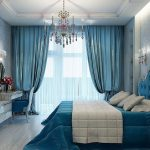 спальня с голубыми шторами и кроватью