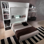 подъемная кровать в белом шкафу