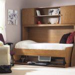 стол-кровать орехового цвета