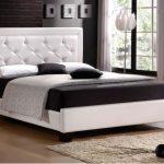 Кровать с высокой мягкой спинкой