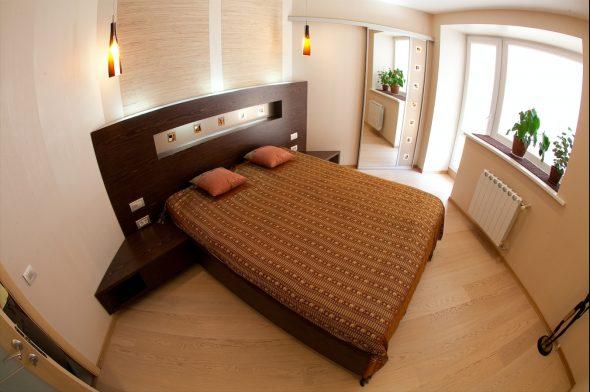 лучше расположить кровать в спальне