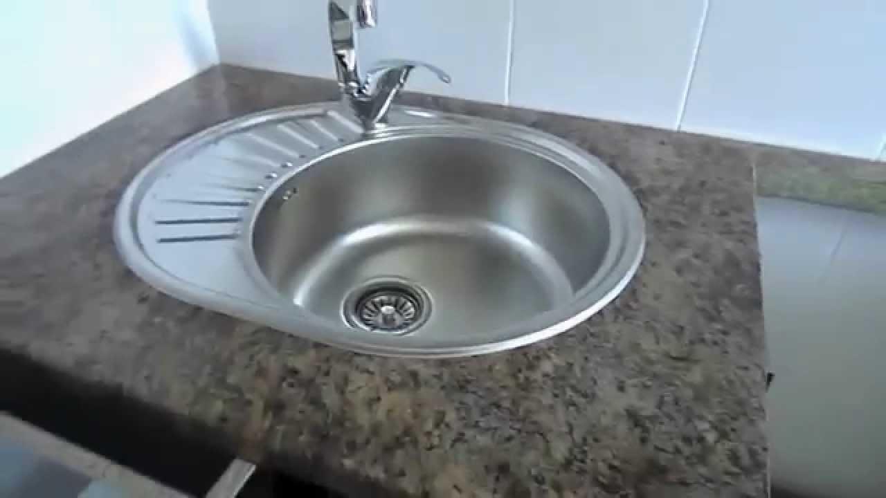 Как врезать мойку в столешницу кухонного гарнитура Как сделать выпил в столешнице для мойки