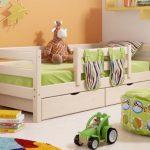 детская кровать с бортиками и ящиками