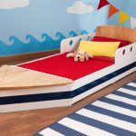 детская кровать с бортиками дизайн