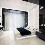 кровать в черно белой спальне