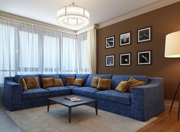 Стены - коричневые, диван - синий