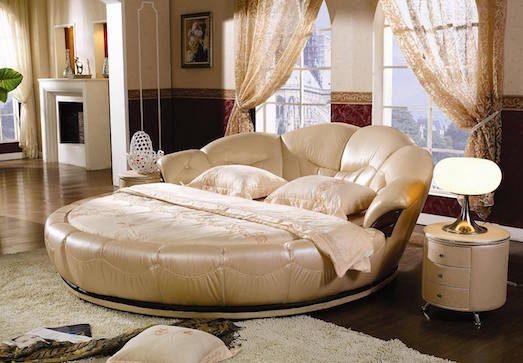 Круглая кровать в интерьере спальни фото
