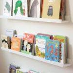 Полки для детских книг над диваном