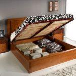 Изящная кровать с вместительным коробом для белья и подъемным механизмом