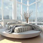 Необычная стеклянная спальня с круглой кроватью-подиумом