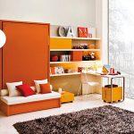 Диван-кровать оранжевого цвета для спальни