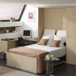 Необычная кровать-шкаф на мансарде