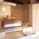 Кровать-подиум с выкатными ящиками в стиле лофт