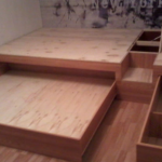 Подиум с выдвижной кроватью и выдвижными ящиками