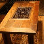 Деревянный стол с кованной решеткой посредине