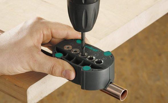 Кондуктор для выполнения отверстий в трубках