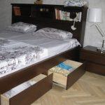 Большая кровать с встроенным изголовьем и полками внизу