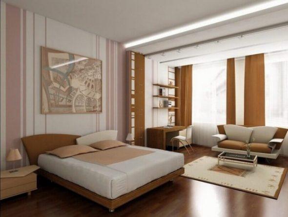 Кровать не отделена от зоны гостиной