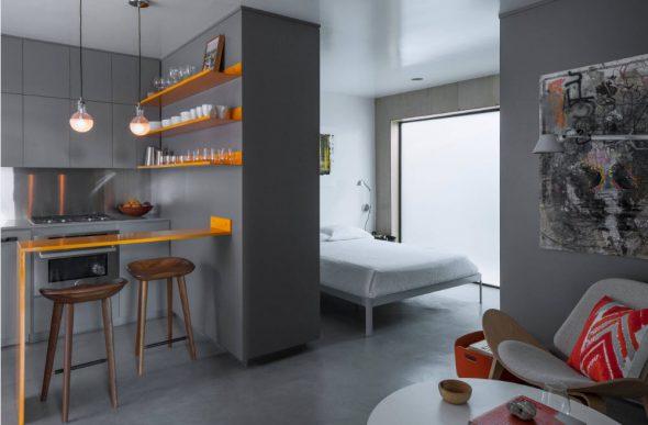 Спальня вынесена в зону возле окна