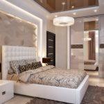 Оформление необычной спальни в бежевых тонах