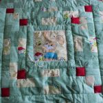 Нежное одеяло для малыша в технике пэчворк