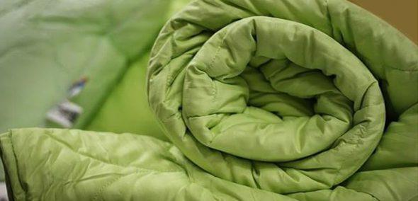 Осмотрите одеяло перед тем, как поместить в машинку