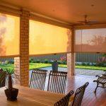 Солнцезащитные роллеты на веранде частного дома