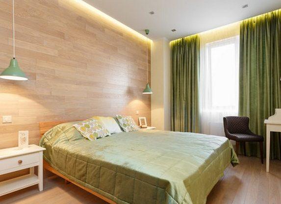 Уютная спальня с оливковым текстилем
