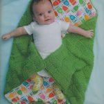 Двустороннее вязанное одеяло с совушками